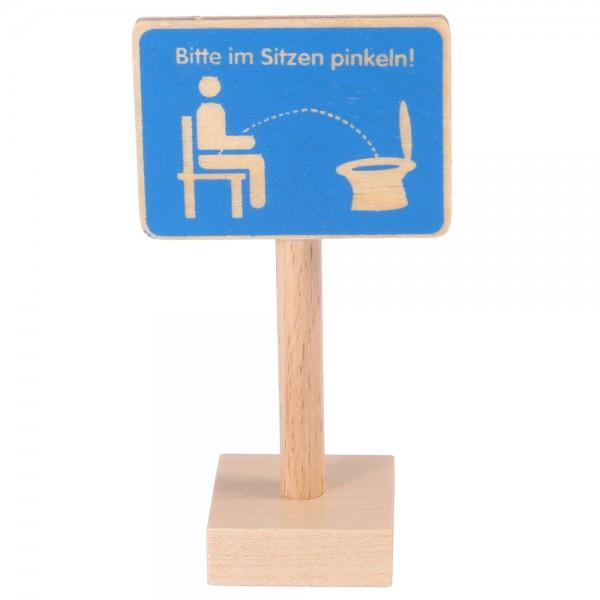 Schild Bitte im Sitzen…