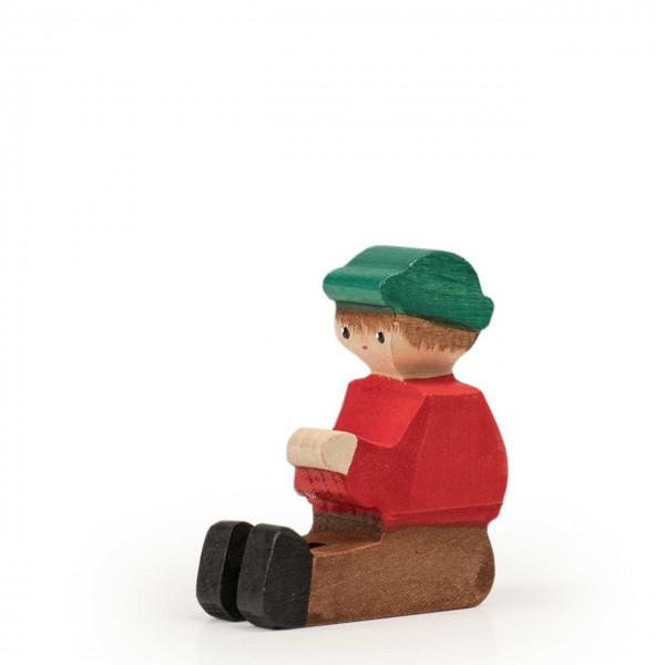 Trauffer Figur Martin sitzend rot